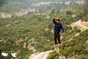Wearing shoes on a line is silly. Just pull them across. 30m - Drop Zone, in Kanyon